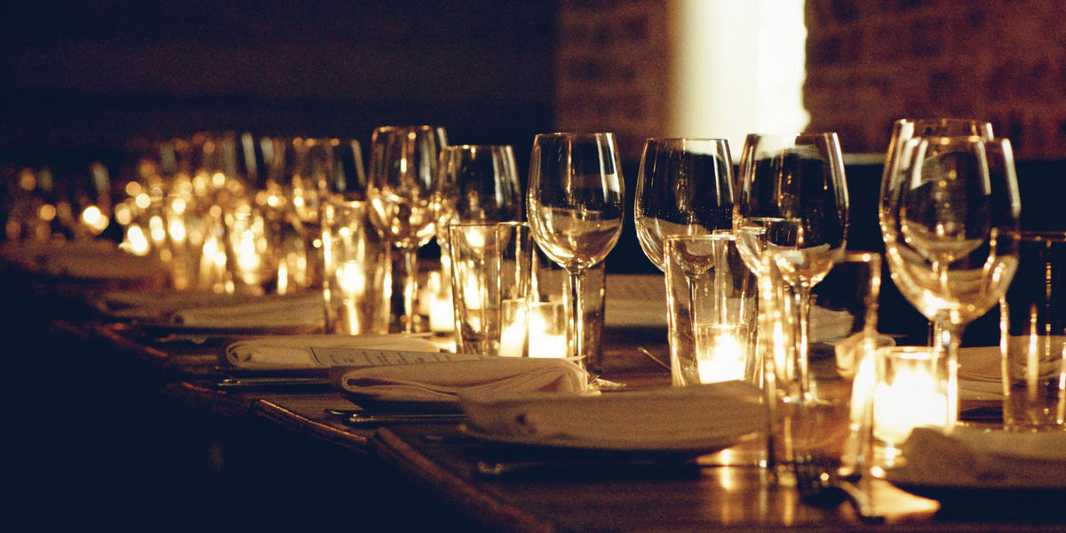 Table set for a dinner with wine glasses